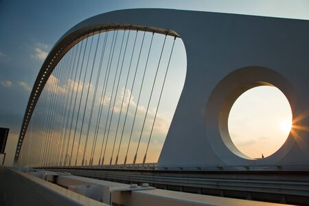 emilia: arch of suspended bridge over the highway Stock Photo