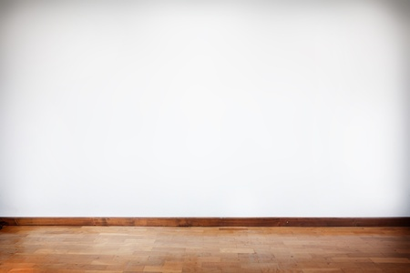 horizontal composition of empty room with white wall and wooden floor Stock Photo - 11453587