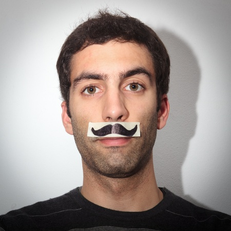 Young guy whit fake moustaches photo