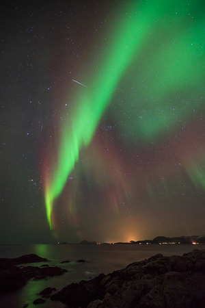 northern light: green norther light of aurora borealis in norway