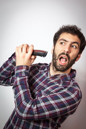 electric razor: young man with beard dont