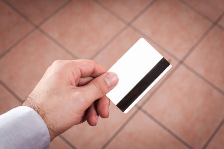 Closeup of a hand holding up a credit card real situation photo