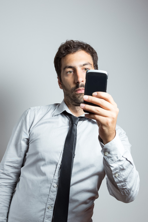 young man in suit taking a selfie frontal view