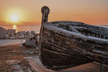 An old tuna boat at sunset in Sicily