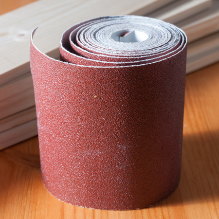 Sandpaper rolls on a wood table