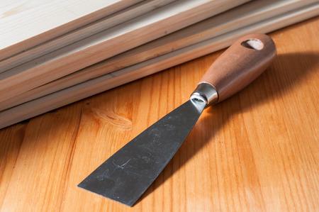 A spackle knife on a work table Фото со стока