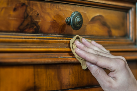 Artisan restoring an old wood furniture Foto de archivo