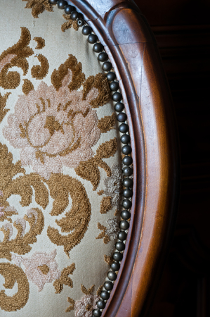 Particular of an old upholstered wood chair to restore Stock Photo