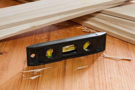 A little tubular spirit level on wooden table Stockfoto