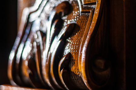 Detail of an oiled inlaid antique wood furniture Standard-Bild