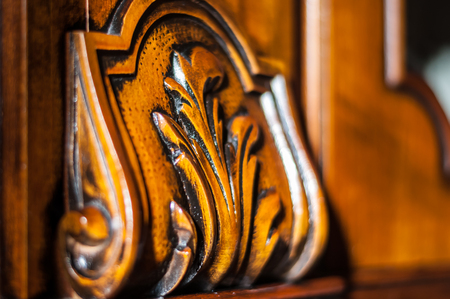 Detail of an oiled inlaid antique wood furniture Stock Photo