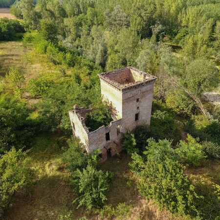 Aerial view of a medieval tower (Cassine, Piedmont, Italy). Square composition.