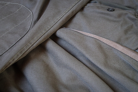 Detail of a pair of old military trousers. Vignette effect.