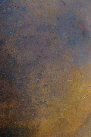 Rusted metal sheet. Vertical composition.