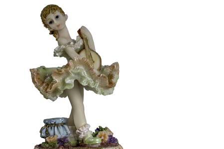 Vintage Girl Figurine wearing petticoat and playing music. 版權商用圖片