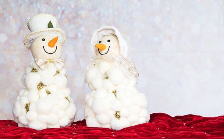 Happy smiling snowman couple. Snowwoman. Christmas Decoration Holiday Card with copy space Reklamní fotografie