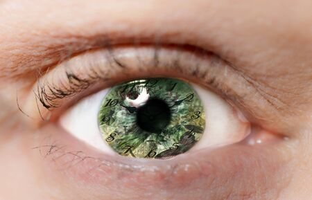 Watch in green eye as a concept of time passing for humans with black hands