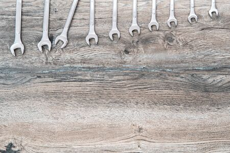 Different size wrenches on wood. Top View with copy space. Tool Concept
