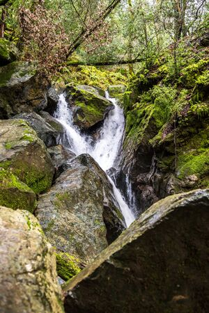 Waterfall and mossy rocks in Sugarloaf State Park, Sonoma Valley, California Reklamní fotografie
