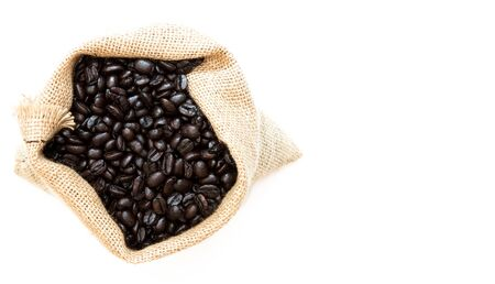 Roasted Coffee Beans in Jute Bag on white background with Copy Space. Top View