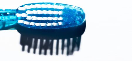 Blue Toothbrush Head with bristles shadows on White Background. Dental Health Concept. Top View with Copy Space