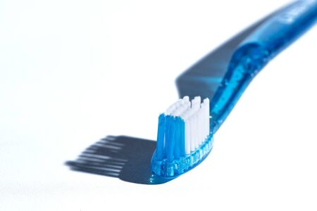 Blue Toothbrush Head with bristles shadows on White Background. Dental Health Concept.  Copy Space