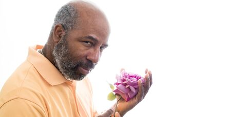African American man holding a purple rose on white background. Romantic Concept of love, valentine's day or Mothers Day. White Background with copy space