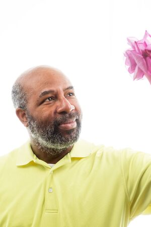 African American man holding a purple rose on white background. Romantic Concept of love, valentine's day or Mothers Day