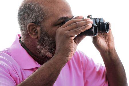 African American man looking through binoculars on white background
