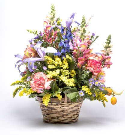 bouquet of bright flowers in basket isolated on white background. Mothers Day or Valentines Day Concept. Banco de Imagens