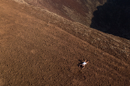 girl is resting on the top of a volcano, fuerteventura
