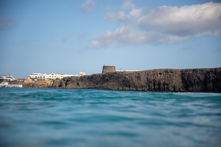 view of the cliff with the Torre del Cotillo, fuerteventura