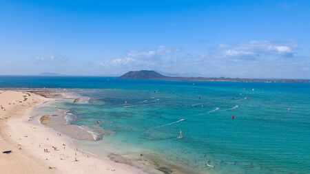 many colorful kites in the Flag Beach on Fuerteventura, Canary Islands
