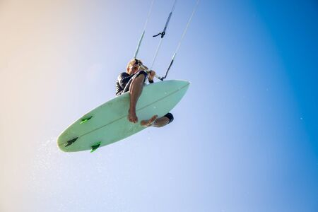 The kite surfer rides the waves of the Atlantic Ocean