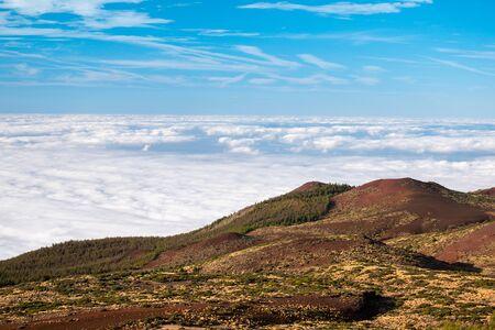 sea of clouds below the summit of Teide volcano in Tenerife