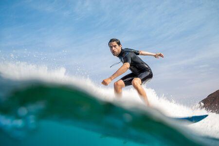 Fuerteventura - September 29, 2019: surfer riding waves on the island of fuerteventura in the Atlantic Ocean Redakční