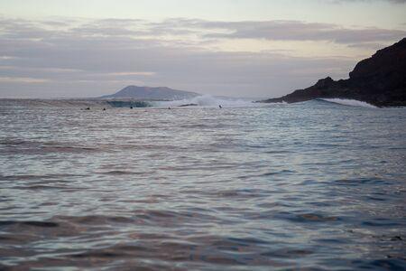 surfer riding waves in the atlantic ocean