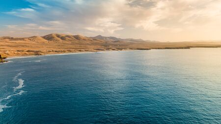Aerial view west coast of Fuerteventura at sunset,images taken near the small village El Cotillo, canary islands