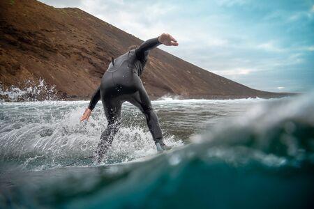 Surfer riding waves on the island of fuerteventura in the Atlantic Ocean, Canary Islands Reklamní fotografie