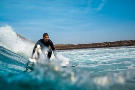 surfer riding waves on the island of fuerteventura