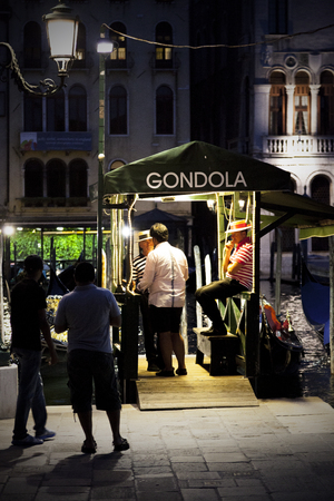 grand canal: Customers waiting for a gondola ride, Grand Canal, Venice, Italy