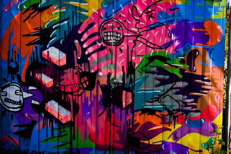 colorful wall of abstract grunge graffiti in Brazil on the island of Florianopolis