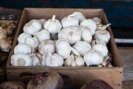 fresh garlic, display of garlic in farmer market photo