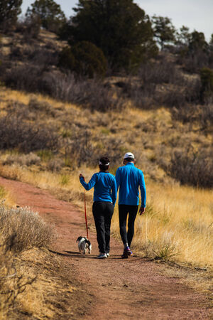 Active couple hiking with dog in Colorado outdoors on a beautiful winter day in Garden of the Gods Park photo