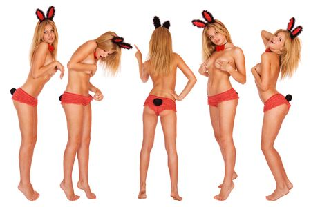 nude babe: five sexy playgirls in bunny costumes isolated on white Stock Photo