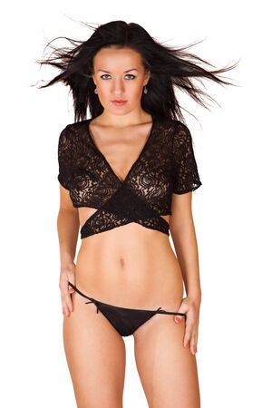 Cute young brunette girl in black transparent panties and bra isolated Stock Photo - 6256047