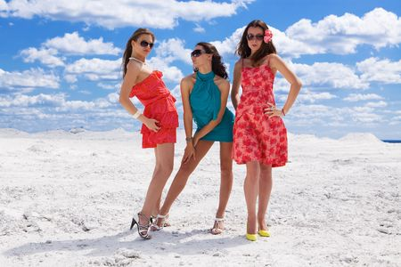 Three Cute sexy girls on the snow posing photo