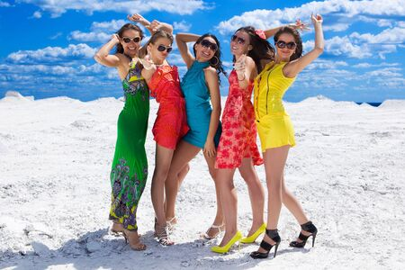 Five Cute sexy girls on the snow ready for party Stock Photo - 7285855