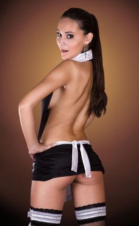 sirvientes: Hermosa mujer cauc�sicos vestido con un traje de sirvienta de franc�s sexy