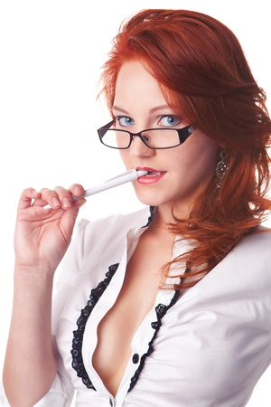 beautiful redhair businesswoman portrait bite a pen isolated on white background photo